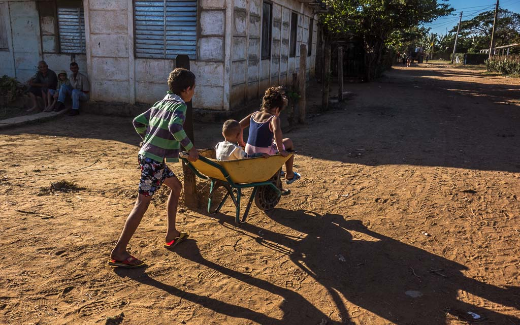 Pojabo children playing Sancti Spiritu Cuba